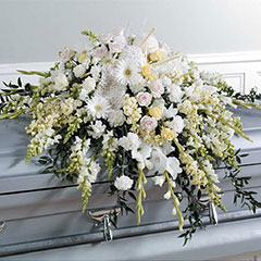 For tasteful funeral tributes at funeral homes, funeral cortege and cemetery, contact Kelowna florist Floral Designs by Lee.